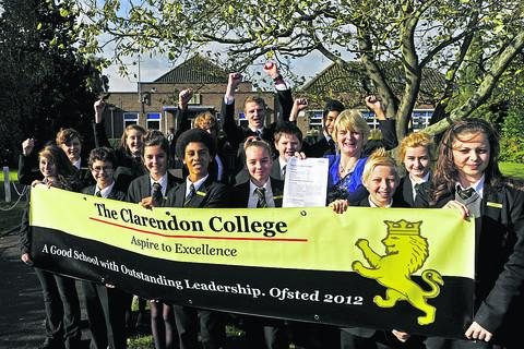 Clarendon College house captains and school ambassadors celebrate with deputy headteacher Catherine Szabo