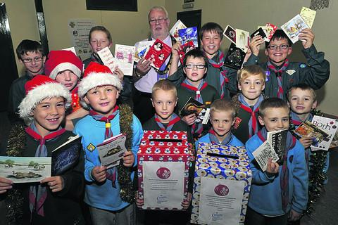 Melksham Scouts, Cubs and Beavers get ready for their Christmas card delivery rounds in the town, which are being supported by Mayor Chris Petty