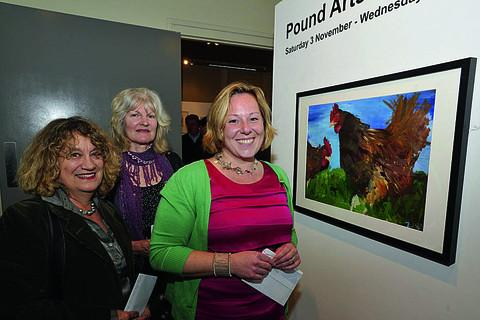 Winner of the Pound Arts open competition Tara Parker-Woolway, right, and her winning painting with runners-up Connie Addison, left, and Sally Jefferies