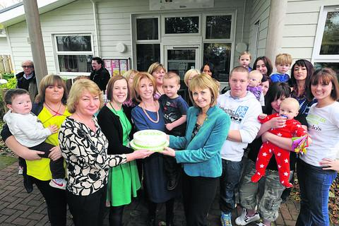 Wiltshire Times: Jane Asher slices into a cake with some staff and parents