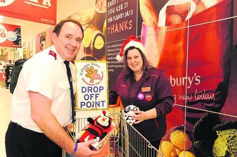 Salvation Army captain Kelvin Lang with Sainsbury's Caroline Cox and some of the toys being collected at the Bradford on Avon branch                     Photo: Trevor Porter (41328)