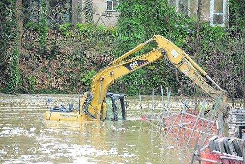 Wiltshire Times: A digger which, ironically, was working on flooding defences at the new housing development in Bradford on Avon