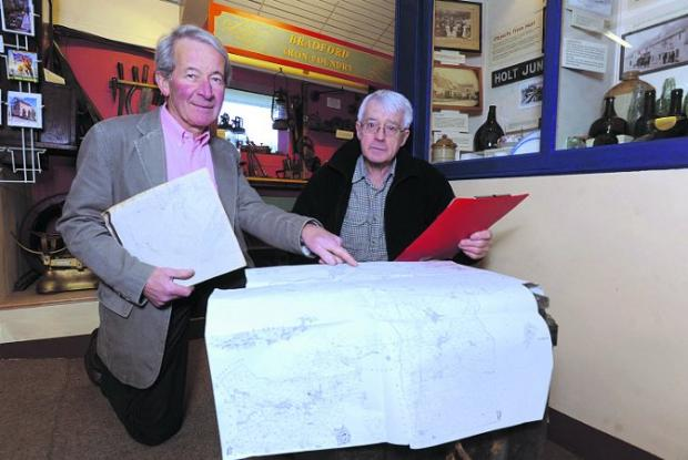 Mervyn Harris and Roy Canham from the museum consulting old maps in preparation for the project Photo: Trevor Porter  (41373)