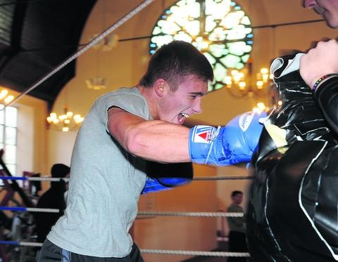 Nick Blackwell hits a body bag during training with Billy Heydon at the town's Contender Gym this week
