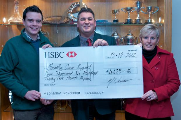 Mike Venner, Upavon Golf Club Captain and wife Mo present a cheque for  £4625 to Daniel McNally of MacMillan Cancer Support