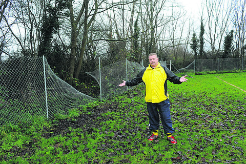 Club chairman Ralph McCaldon by the damaged fencing