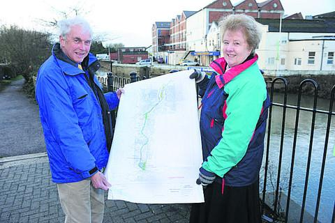Richard Wiltshire of the Town Trust and deputy mayor Terri Walsh with plans for the Wilts & Berks canal at Melksham