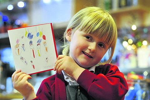 Olivia Hunt with her prize-winning Christmas card design