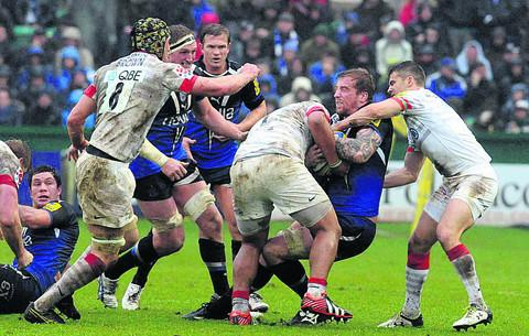 Bath's Dominic Day is pulled down by the Saracens defence (Photo: Bob Ascott)