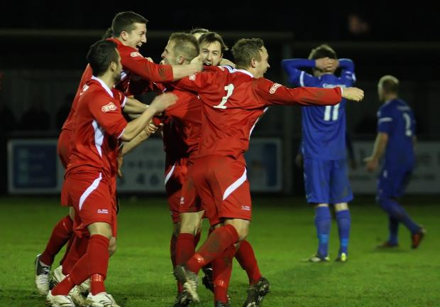 Frome's Dean Evans is mobbed by his colleagues after his magnificent last-gasp equaliser (Picture by Robin Foster)