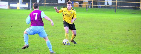 Melksham's Luke Smith goes on the attack during Tuesday's home defeat Photo: Diane Vose
