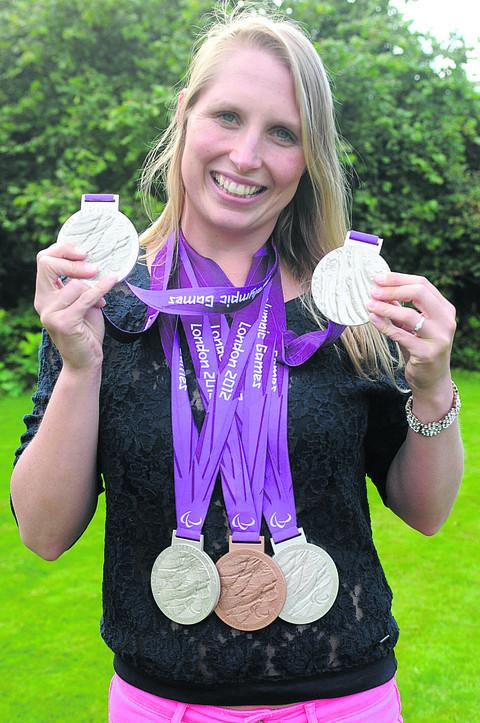 Stephanie shows off the spoils gained from the London 2012 Paralympic Games this summer