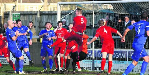 Frome's Ryan Bennett (4) heads into his own net for Chippenham's opener during Tuesday's 2-2 draw (Picture by Robin Foster)