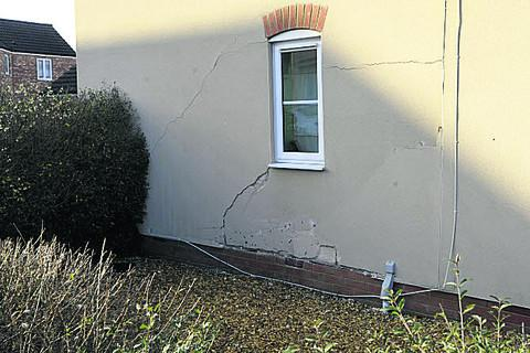 The house on the corner of Old Farm Road and West Ashton Road, Trowbridge, damaged after being hit by a car on Friday