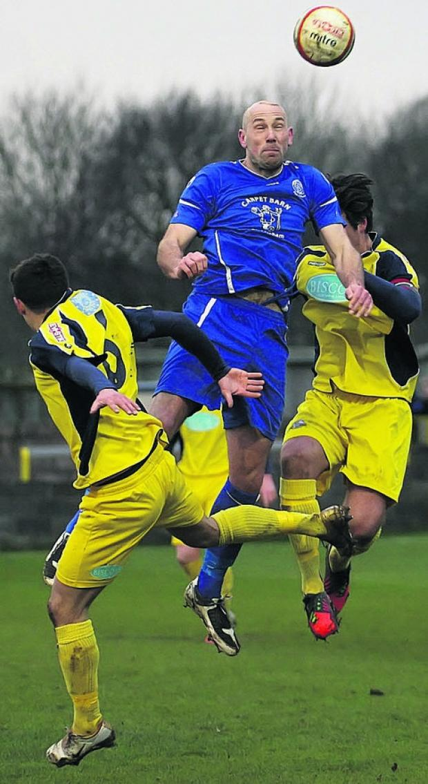 Wiltshire Times: Aaln Griffin rises high in Chippenham's draw with Gosport last weekend