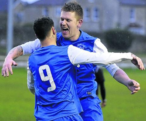 Matt Minnis helps Nick Ridout (right) celebrate scoring Bradford Town's second goal against Hengrove Athletic last weekend
