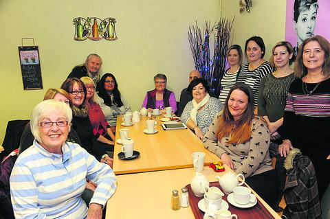 Lesley Tapp, seated second from right, with members of the Fibromyalgia  support group she set up following an article in the Wiltshire Times