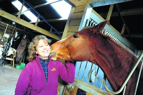 Horse trainer Claire Lilley with six-year-old Ruby at her stables Little Copse Farm