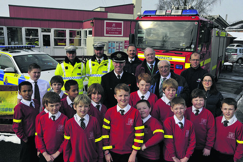 Aloeric Primary School pupils in Melksham get their free reflective arm bands at the start of a countywide road safety campaign