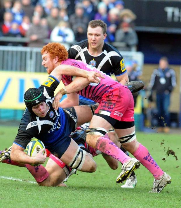Bath's Mat Gilbert is pulled down by Exeter's Joel Conlon (Photo: Bob Ascott)