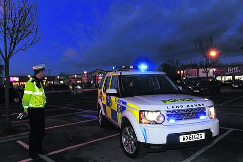 Police patrol the Bradley Road retail park before Christmas