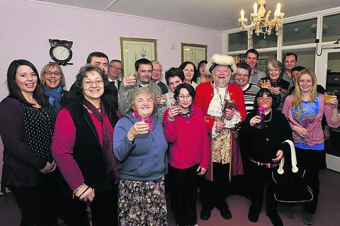The OLPA charity celebrates its 10 years in Trowbridge, with a party for current and former residents, helped along by town crier Trevor Heeks