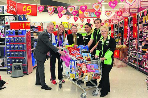 Paralympian Stephanie Millard helps Melksham Rotary president Warwick Allen and Asda staff Gary Salter, Naomi King, Matt Cameron and Kay Wallace to launch the Rotary Great Trolley Dash