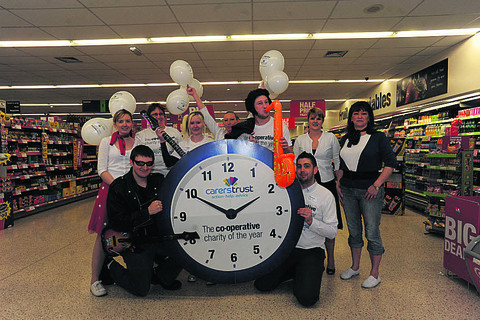 Manager Rob Mead and staff at the Co-operative food store in fancy dress for their rock and roll themed fundraising launch