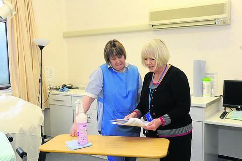 Matron Beryl Orchard discusses the CQC report, which praises the Trowbridge unit's hygeine standards, with cleaning staff member Samantha Phillips