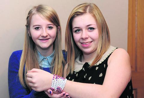 Cousins Rose Carnohan, left, and Megan Slip with some of their bead bracelets