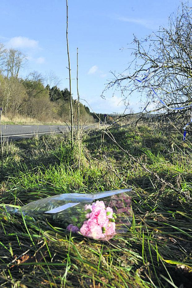 A floral tribute at the scene of the crash today