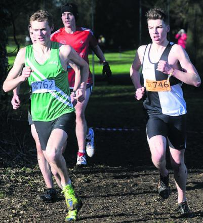 Alex Carter (green) leads Swindon New College's Nyle Clinton during the senior boys' race on Saturday