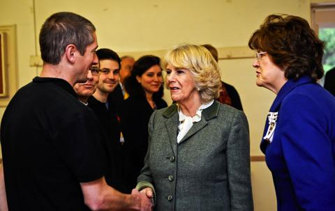he Duchess of Cornwall meets firearms and drugs sniffer dog Eric the black Sprocker and owner Stuart Phillips