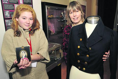 Wiltshire Times: Curator Claire Lyall with volunteer Lucy Smith, left, and a coat belonging to mill owner John Plummer Clark and his portrait, from about 1820