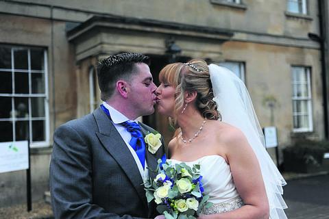 James and Lisa celebrate with a kiss on their wedding day