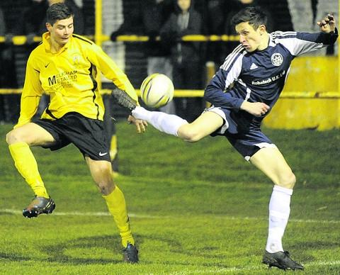 Melksham's Will Stead (yellow) loses out to a cheeky back-heel from Bradford's Steve Hulbert during Monday's Wiltshire Senior Cup quarter-final