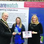 The mayor of Trowbridge John Knight and care manager Jessica Walder, present the award to Rose Scarff, centre