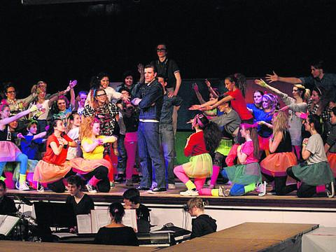 The cast of Back to the 80s in action on stage at Matravers School