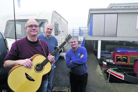 Terry Helyar, centre, with Warminster songwriter Paul Rogers and Hilperton Marina manager John Froggatt, right