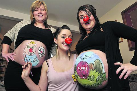 Artist Lorna Blake, centre, with Trish Reader, left, and Fran Rich modelling their Comic Relief baby bumps