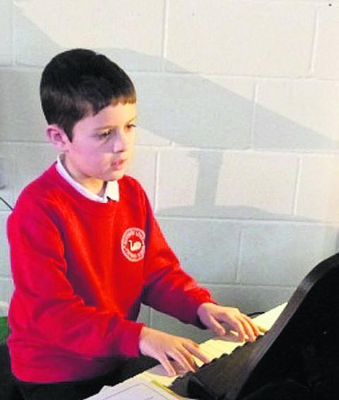 Young pianist Oliver Willis at his keyboard