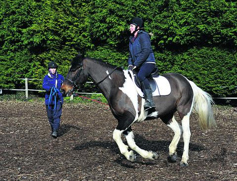 Heather Marshall gives Miss Millward a riding lesson