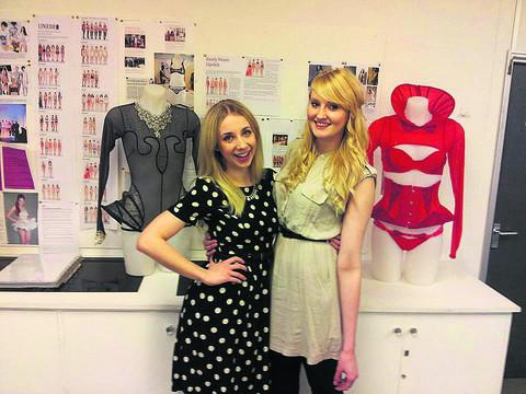 De Montfort University lingerie design students Phoebe Plows, left next to her sheer grey outfit, Christina Hallett-Young, right with her red creation