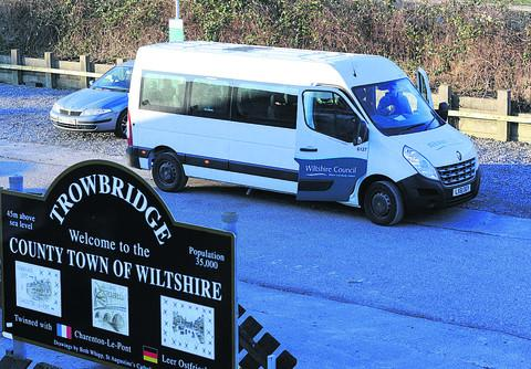 The Wiltshire Council minibus waiting at Trowbridge railway station, one of the pick-up points, to take staff to its Shurnhold offices