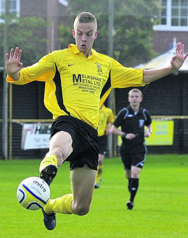 Gary Higdon (yellow) scored twice in open play and netted a penalty in the shootout as Melksham progressed to the Wiltshire Senior Cup final