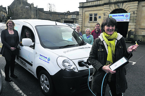 Shay Parsons, front, with the electric van and Amy Starr, Sylvia Tate, Kevin Sharpe, Maureen Wood and Rowena Quantrill