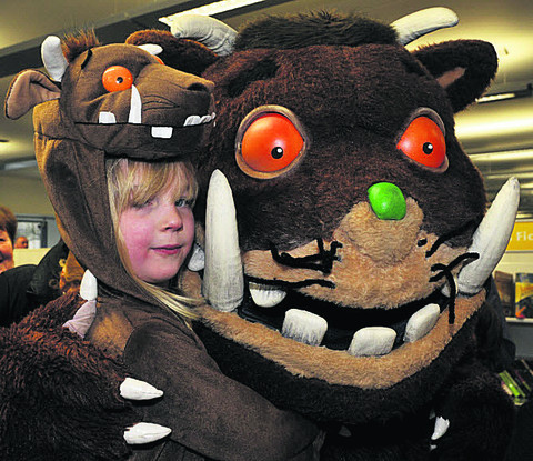 Eva Cadby, five, gets up close to the Gruffalo during his visit to Trowbridge Library
