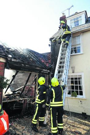 Firefighters at the scene of the fire in Seend today
