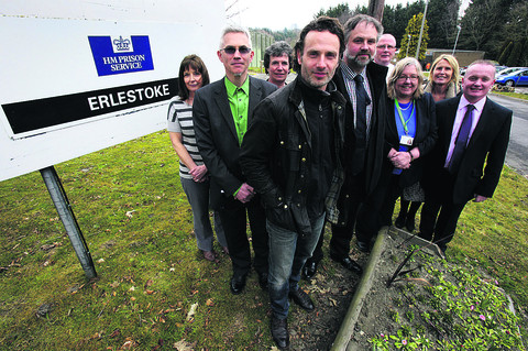 l Andrew Lincoln with Barnardo's South West assistant director Tim Carter, left, Erlestoke governor Andy Rogers, right, and the visitor centre team