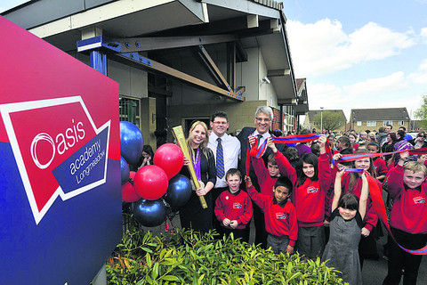 Paralympian Stephanie Millward does the honours to officially relaunch the primary school as the Oasis Academy Longmeadow, with Steve Chalke, centre right, founder of the Oasis Trust, school principal Craig Gibbens and pupils in their new uniforms
